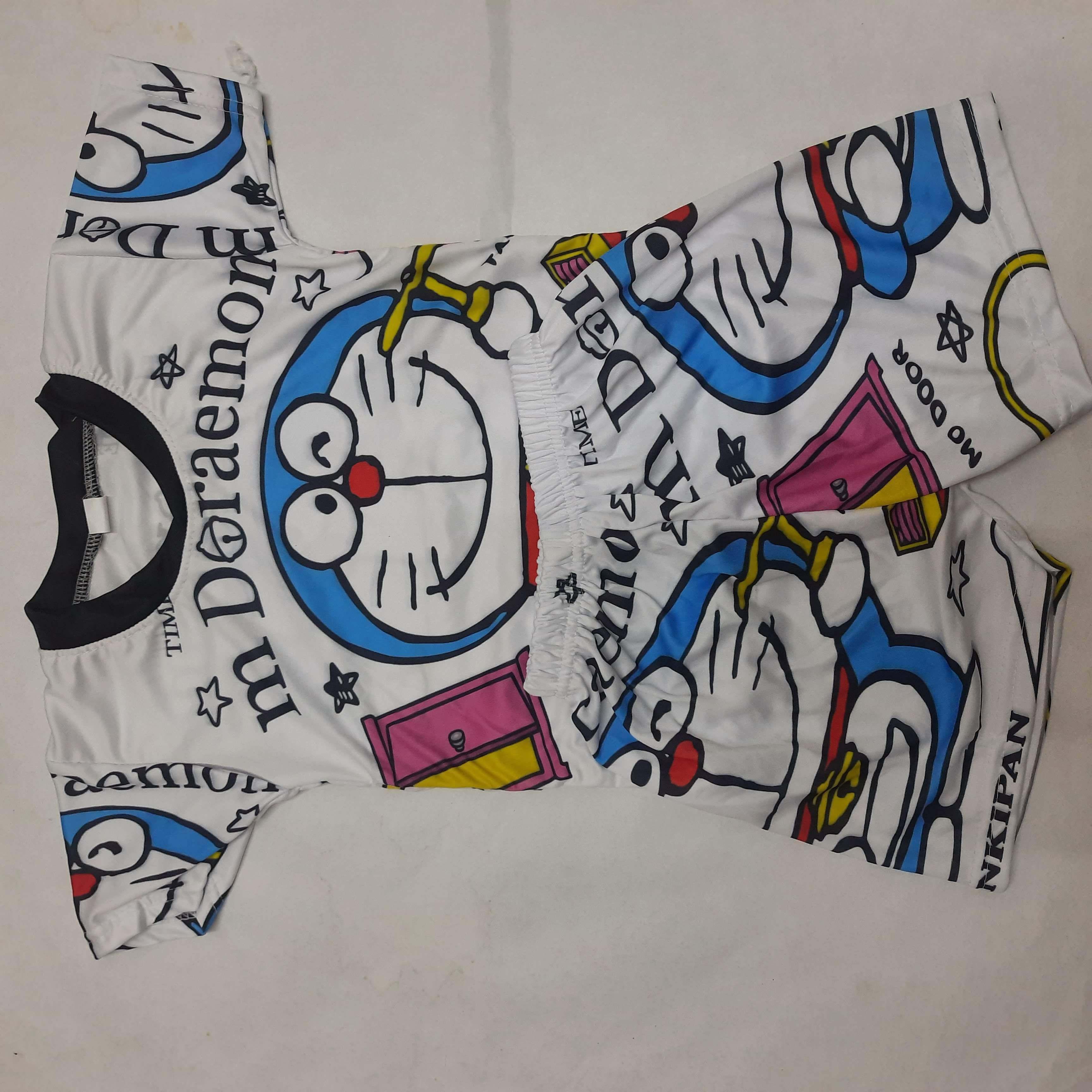 ชุดเด็ก ไซส์ S อก22นิ้วผ้ามันพิมพ์ลายการ์ตูนหน้าและหลัง 6-12 โล